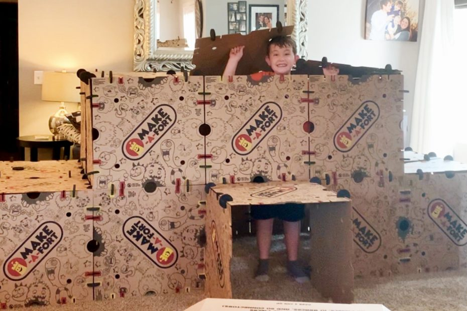 Boy popping out top of fort